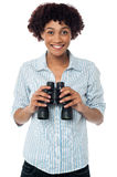 Smiling afro american woman holding binocular Royalty Free Stock Images