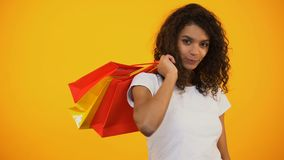 Smiling Afro-American woman holding shopping bags, Black Friday discount. Stock footage stock video