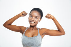 Smiling afro american woman showing her biceps Royalty Free Stock Photo
