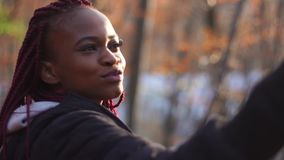 Smiling afro-american woman is taking selfie. The close-up portrait. stock footage