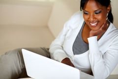 Smiling afro-American woman using laptop Stock Image