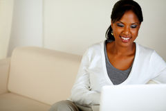 Smiling afro-American woman using laptop Stock Photography