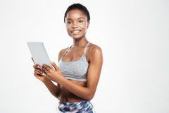 Smiling afro american woman using tablet computer Royalty Free Stock Image