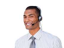 Smiling afro businessman with earpiece on Stock Image