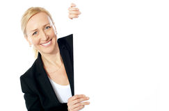 Smiling aged female executive holding clipboard Stock Photos