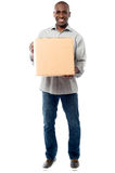 Smiling aged holding carton box Royalty Free Stock Image