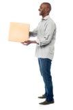 Smiling aged holding carton box Stock Photos