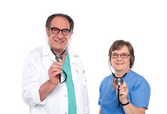Smiling aged male and female doctors Royalty Free Stock Photography