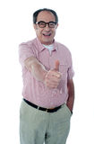 Smiling aged male gesturing thumbs-up. Portrait Royalty Free Stock Photo