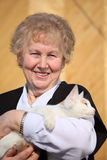 Smiling aged woman with cat Stock Photos