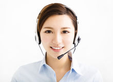 Smiling agent business woman with headsets Stock Images