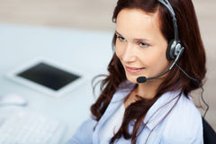 Smiling agent. Smiling call center agent working with headset Royalty Free Stock Images