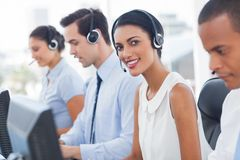 Smiling agent with colleagues sitting Stock Images