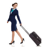 Smiling Air Stewardess Walking With Trolley Bag Isolated Stock Images