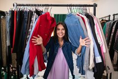 Smiling alluring radiant beaming woman having fun in the showroom. Having fun in the showroom. Smiling alluring radiant beaming charming happy dark-haired woman royalty free stock photo