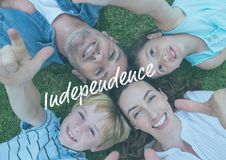 Smiling american family lying down on the grass Stock Images