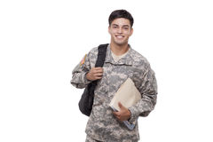 Smiling American soldier with documents and backpack Royalty Free Stock Photos