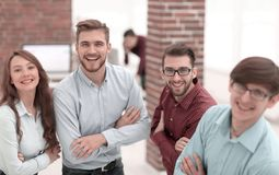 Smiling american team discussing business project during coffee royalty free stock photography