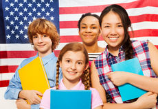 Smiling American teenage students with textbooks Royalty Free Stock Image