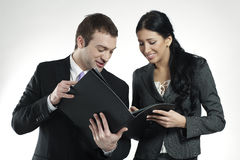 Smiling An And Woman Looking At Business Portfolio Stock Photos