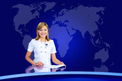 Smiling anchorwoman at TV studio Stock Photo