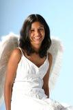 Smiling Angel. Teenage girl dress like an angel royalty free stock photography