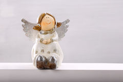 Smiling angel on white background with empty space for text Stock Photo