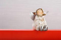 Smiling angel on white and red background with empty space for t Royalty Free Stock Photos