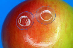 Smiling apple Stock Image