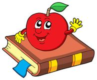 Smiling apple on book Stock Photography