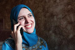 Smiling arab muslim woman with mobile  Stock Photo