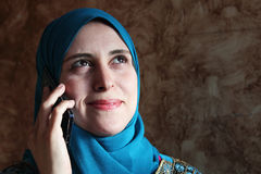 Smiling arab muslim woman with mobile and tablet Royalty Free Stock Image
