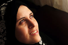 Smiling arab muslim woman searching hope Stock Photos