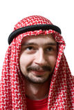 Smiling arabian young man. Portrait of smiling arabian young man in traditional headscarf - shemagh Stock Photo