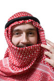 Smiling arabian young man. Portrait of smiling arabian young man in traditional headscarf - shemagh Royalty Free Stock Photography