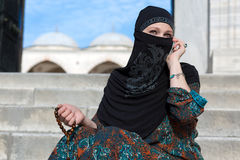 Smiling Arabic Woman Talking on Telephone Royalty Free Stock Photography