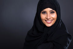 Smiling Arabic woman. In traditional clothing on black background Royalty Free Stock Photos