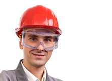 Smiling architect. Engineer, or supervisor in red hardhat Stock Photos