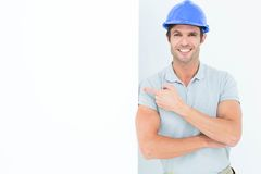 Smiling architect with bill board over white background Royalty Free Stock Image