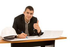 Smiling architect giving a thumbs up gesture Stock Photo