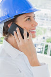 Smiling architect having a phone conversation Stock Photo