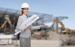 Smiling architect in helmet with blueprint Royalty Free Stock Photos