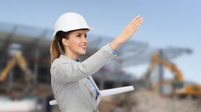 Smiling architect in helmet with blueprint Royalty Free Stock Images