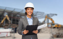 Smiling architect in helmet with blueprint Stock Image