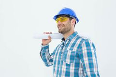 Smiling architect looking away while holding blueprint Royalty Free Stock Photos