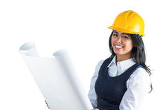 Smiling architect looking at plans Royalty Free Stock Photography