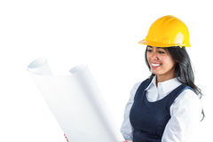 Smiling architect looking at plans Stock Photo