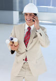 Smiling architect on phone Stock Image