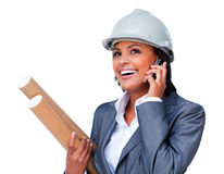 Smiling architect on phone wearing a hardhat Royalty Free Stock Images