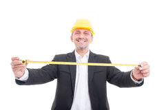 Smiling architect posing holding measuring tape Royalty Free Stock Photos